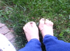 [Image: Playing in grass with bare feet]